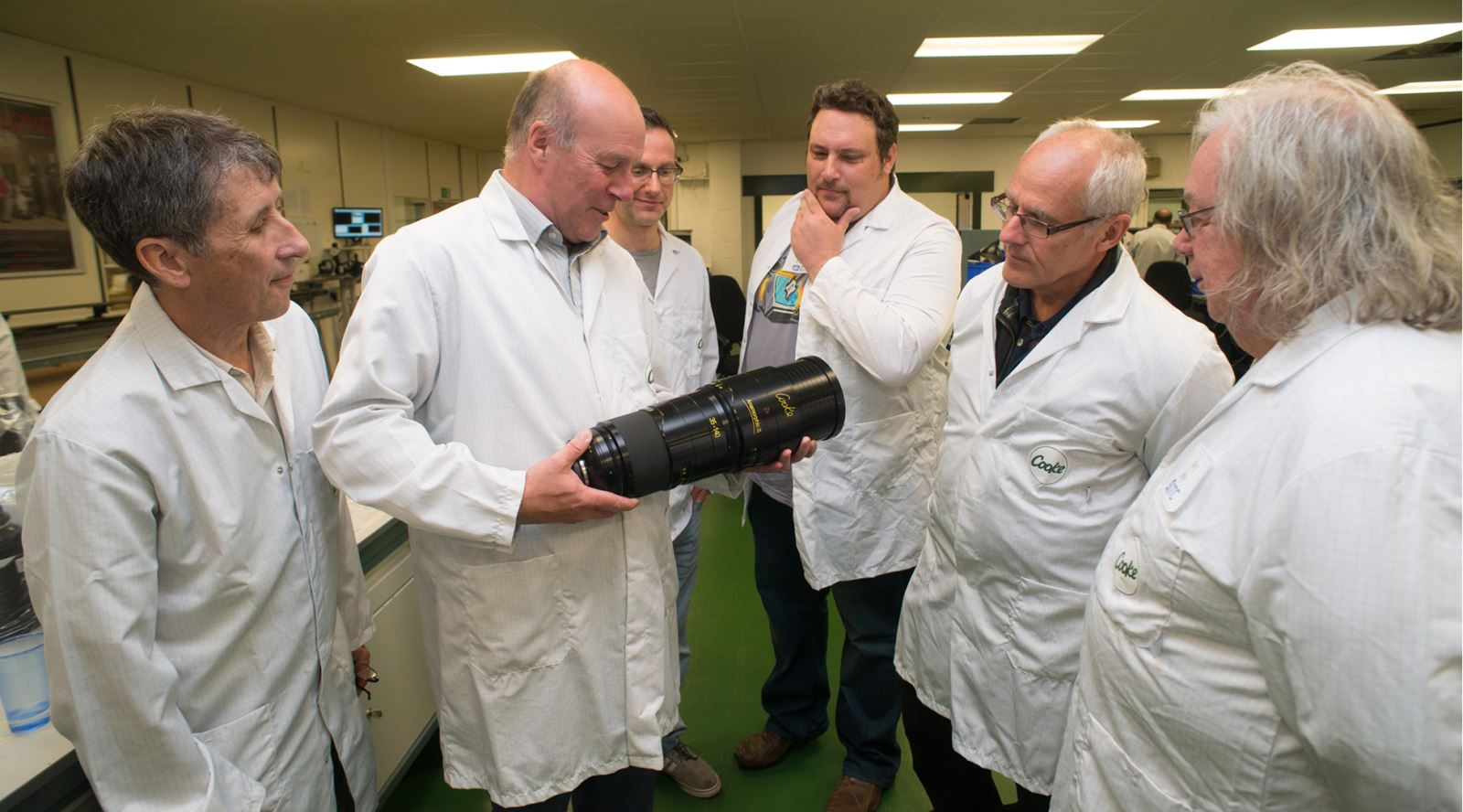 GTC members admiring a Cooke Optics lens on the recent tour of the Cooke factory in Leicester