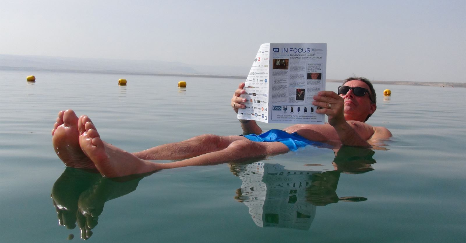 GTC Chair Graham Maunder catches up with some GTC reading in the Dead Sea on a recent filming trip