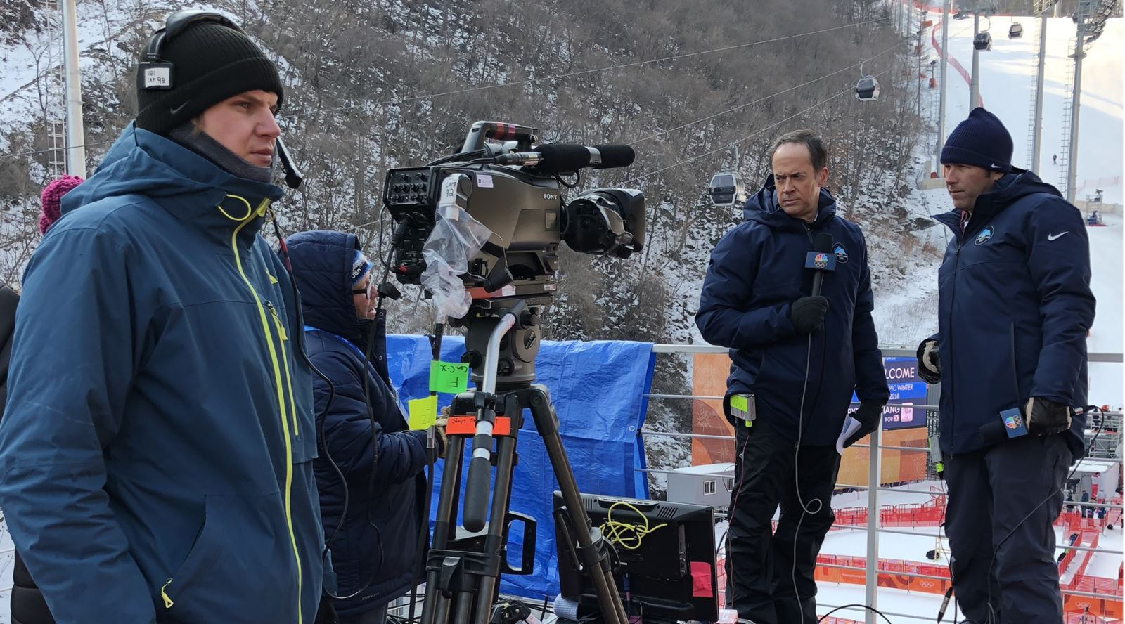 Well wrapped up: NBC presenters about to film a piece to camera at the Downhill Skiing course in Korea