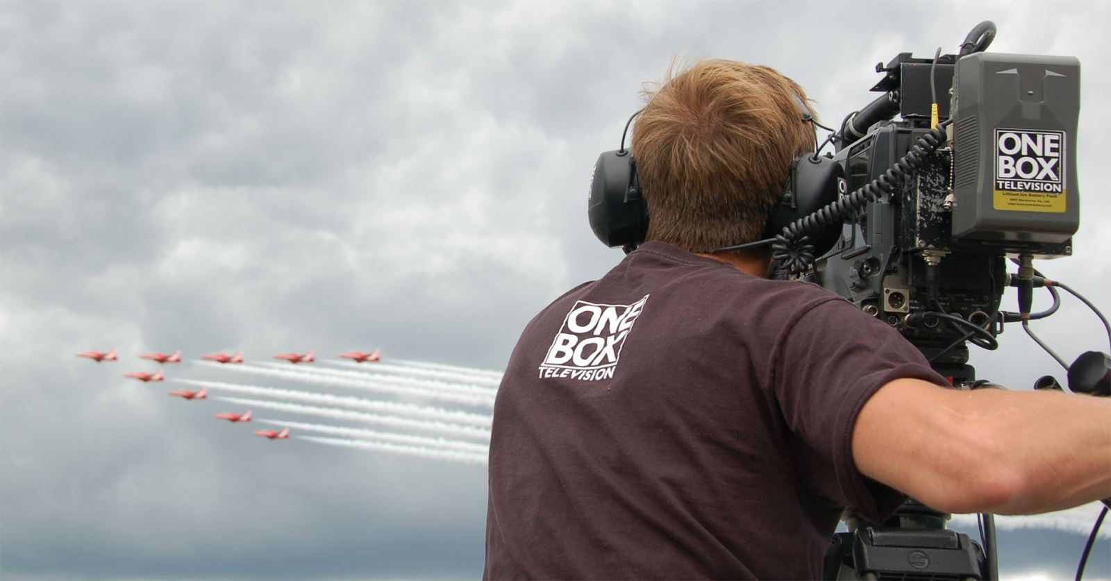 One Box TV camera operator filming the Red Arrows at the Farnborough Air Show