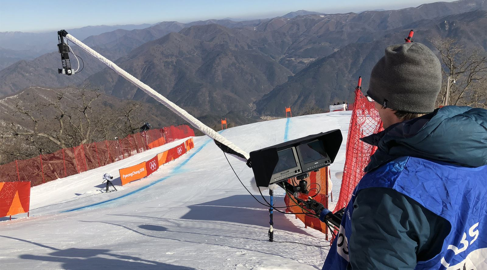 Swiss cameraman Qwer Jorns operating Polecam at  the start of Men's Downhill in Korea