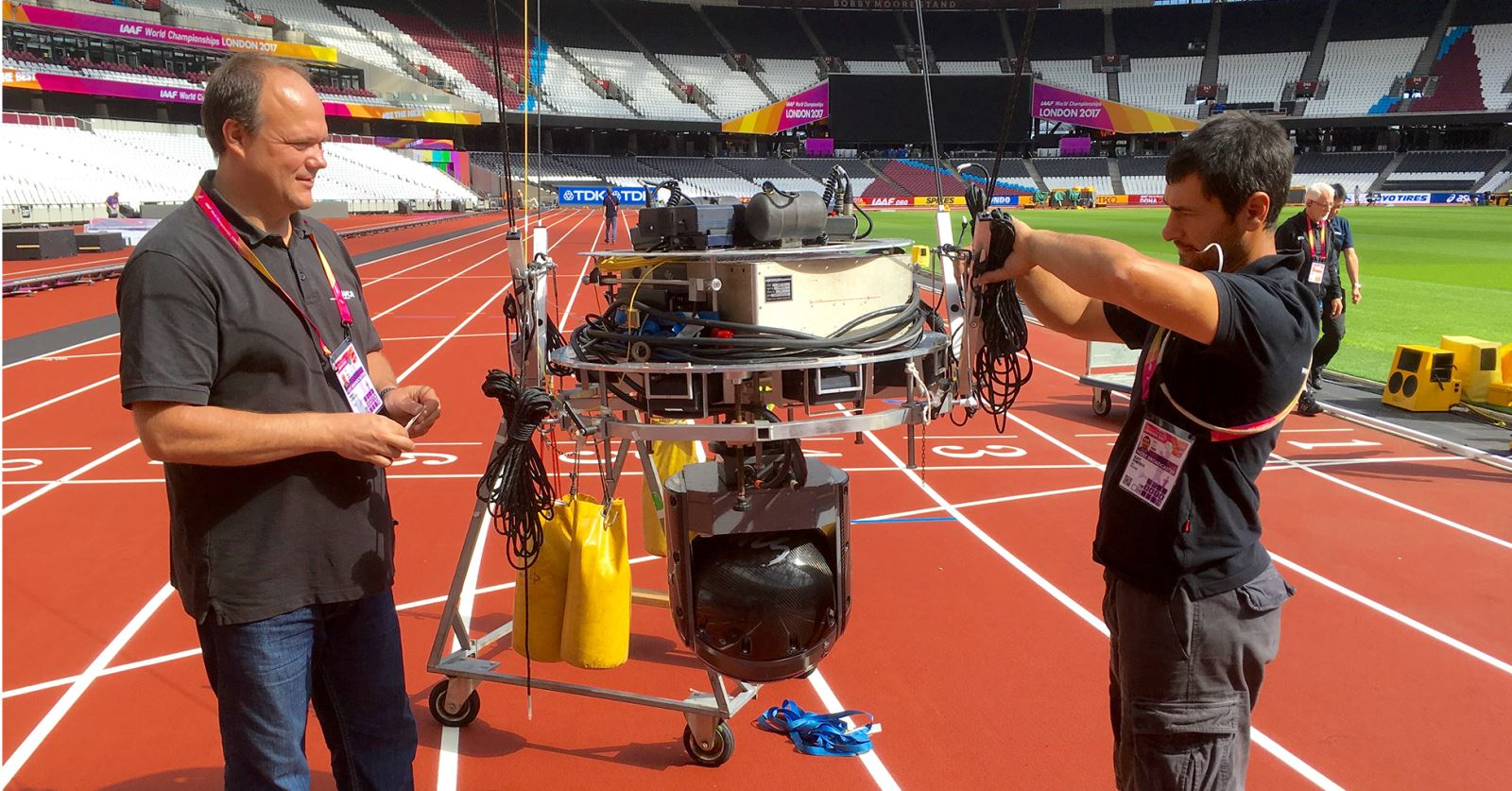 GTC sponsor ACS preparing a 'wirecam' mount of the Olympic Stadium finish line ahead of the IAFF World Championships